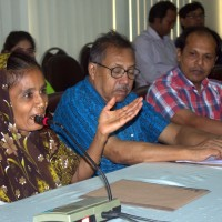 A landless woman speaks at a national level seminar